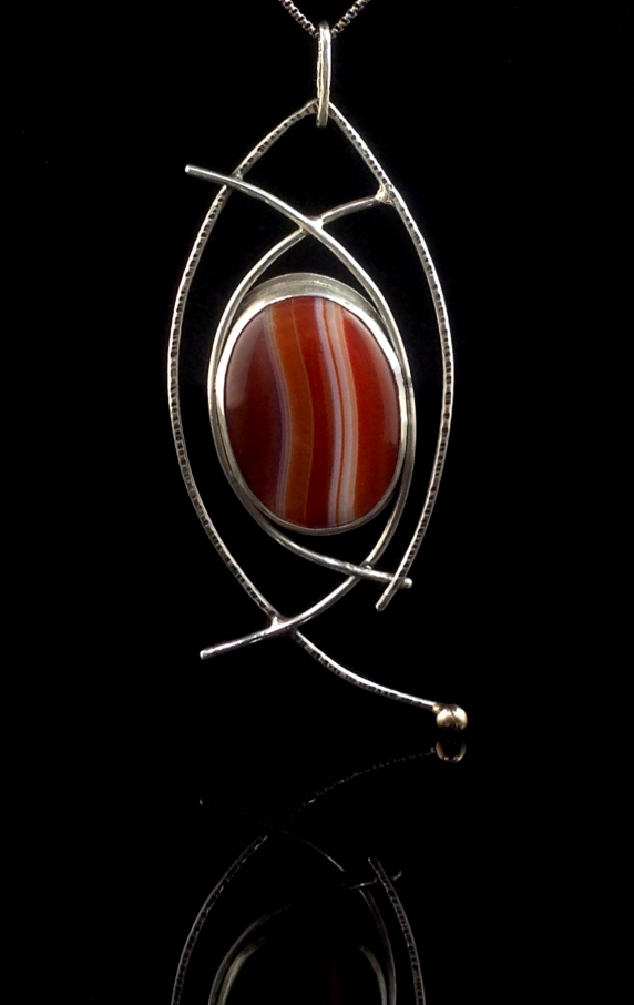 sterling silver wire, Red/White agate cabochon and a brass accent