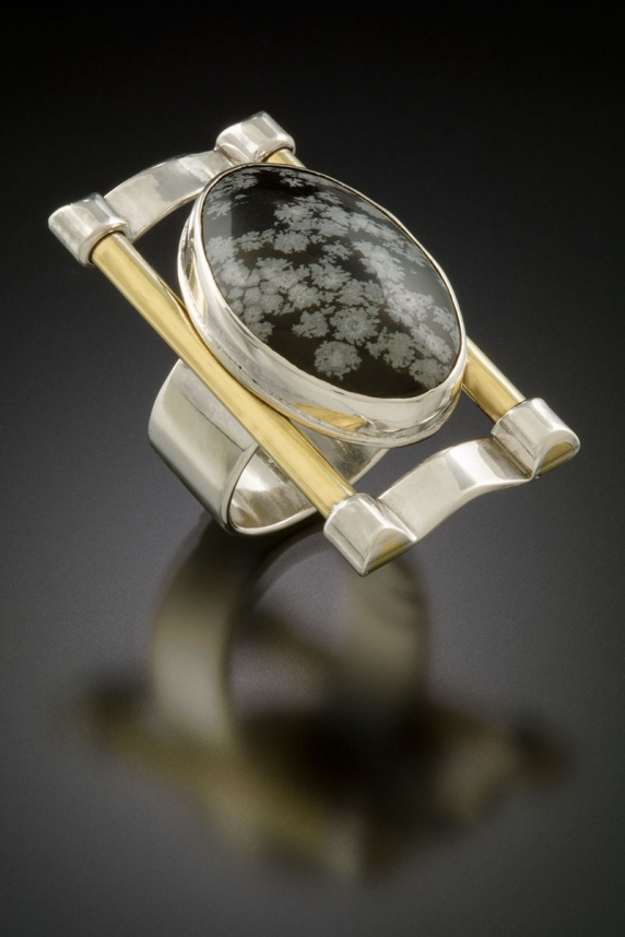Sterling silver, brass, snowflake obsidian
