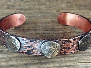 Copper bracelet with Texas quarter centers